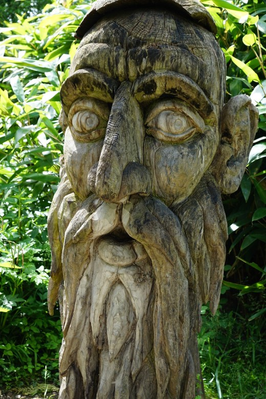 Wood-carved face