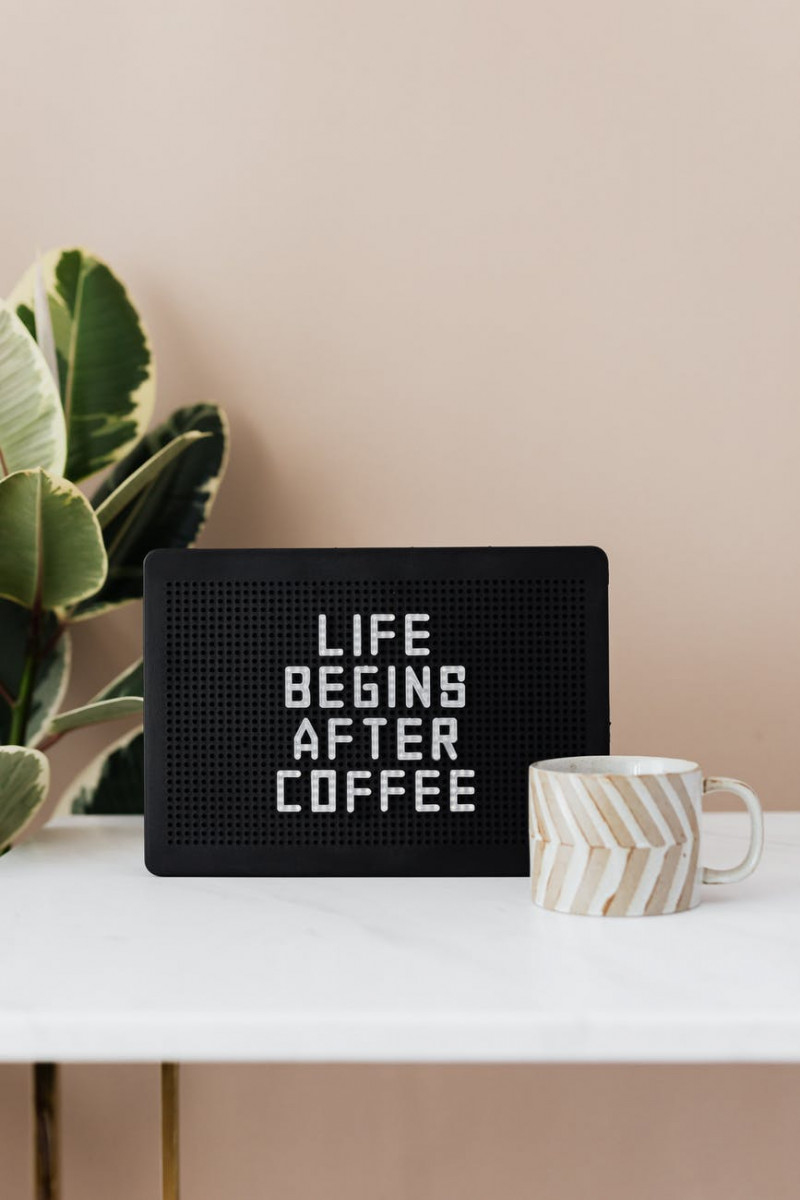 board with life begins after coffee message and coffee cup
