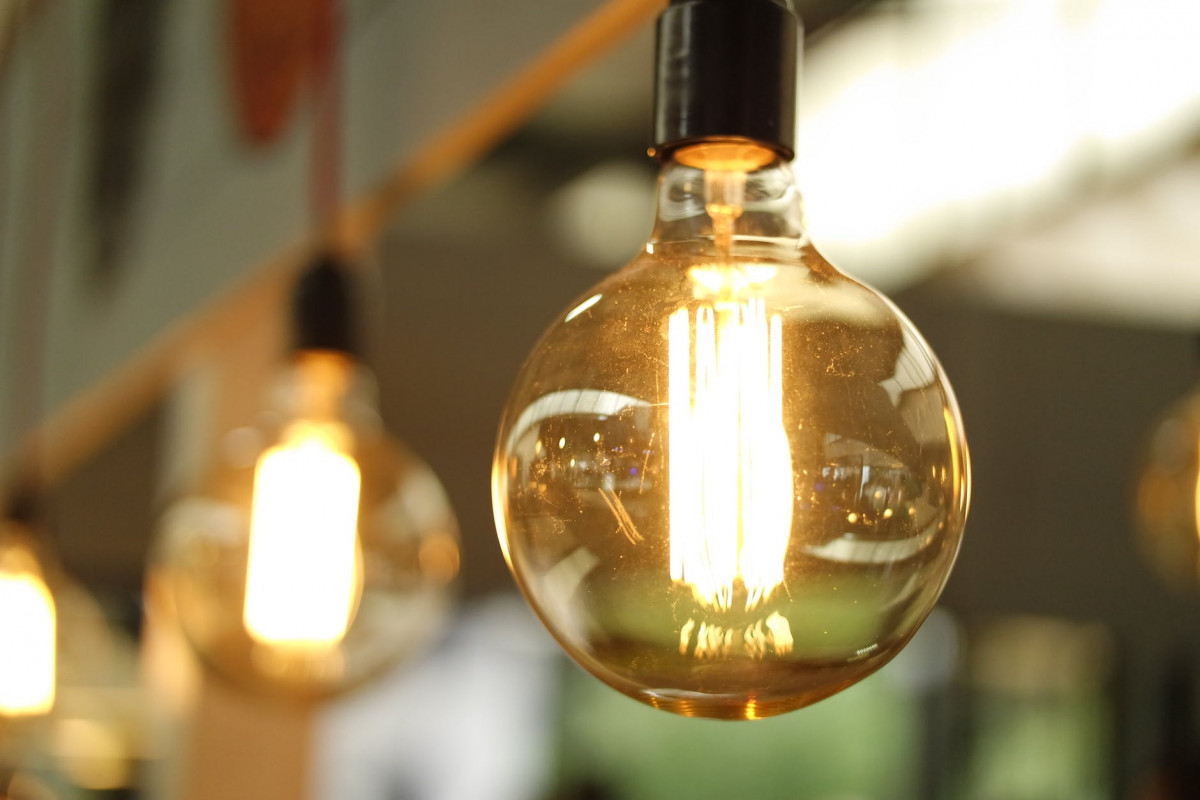 lighted light bulb in selective focus photography