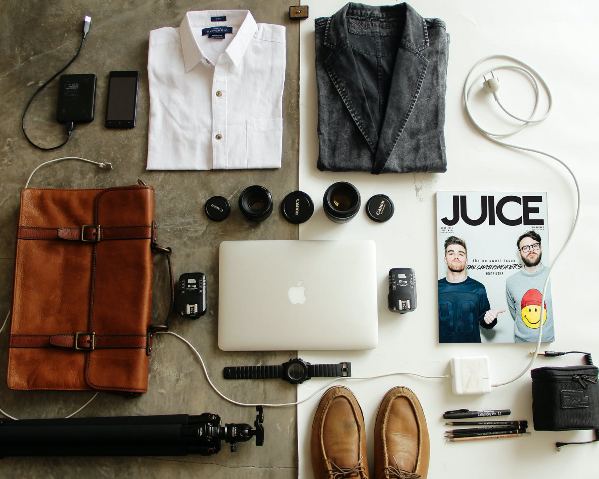 brown leather bag clothes and macbook