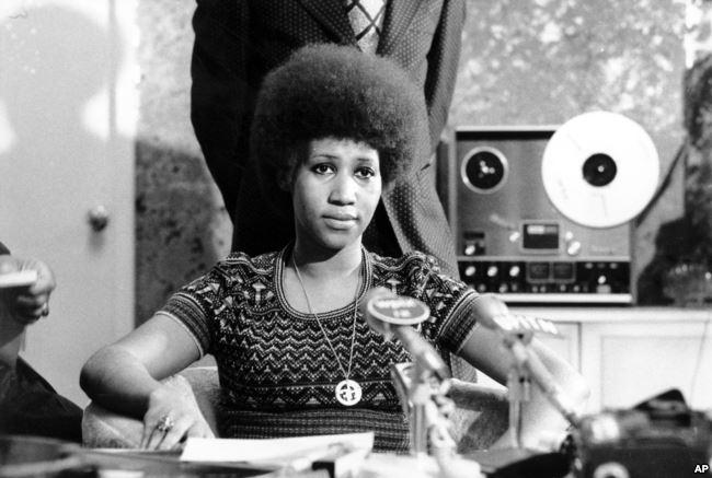 FILE - Aretha Franklin appears at a news conference, March 26, 1973.