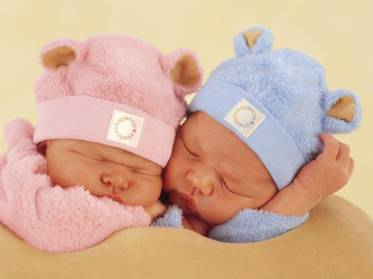 109328-cute-baby-two-little-sleeping-babies-one-with-pink-and-one-with
