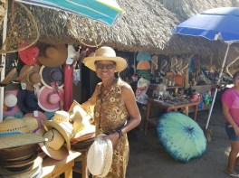 Buying a hat at Puerto Ventanilla