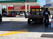 Stop to fill up rental car at Pemex gas station by Huatulco airport.