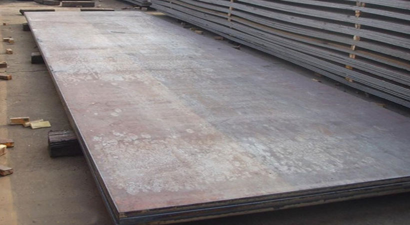 Stainless steel plates in a workshop.