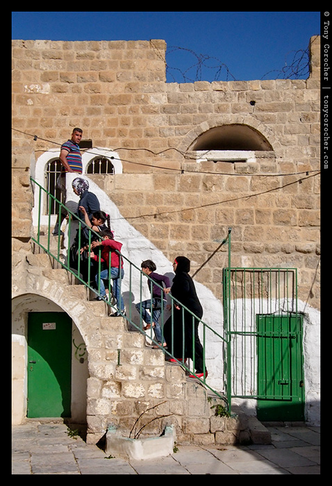 Family visiting an old mosque in West bank - 2013 © Tony Corocher | All Rights Reserved