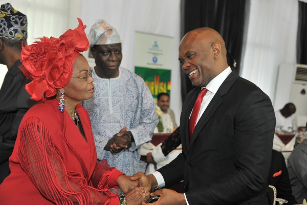 Tony O. Elumelu exchanging greetings with popular fashion entrepreneur, Chief (Mrs.) Opral Benson, D.IoD OON