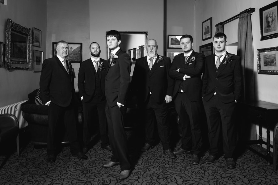 groom and the boys moody portrait at Seiont manor wedding
