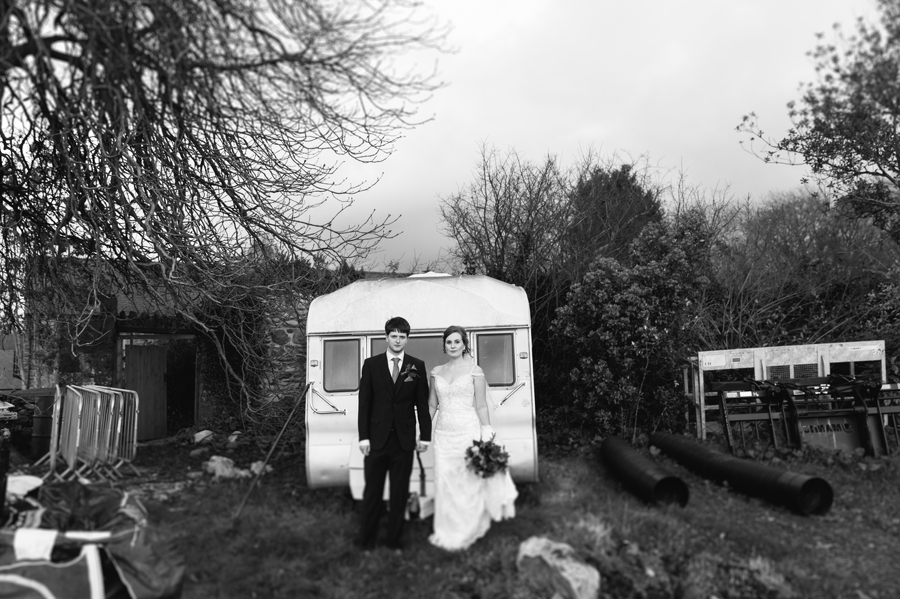 Seiont manor wedding bride and groom standing by a caravan in building site