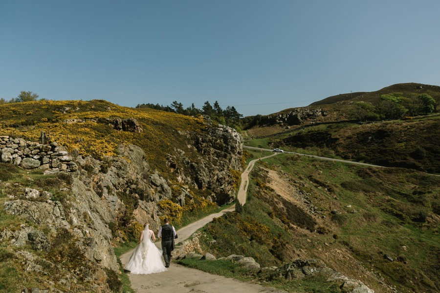 bride and groom walking down Sychnant Pass. Get married in North Wales