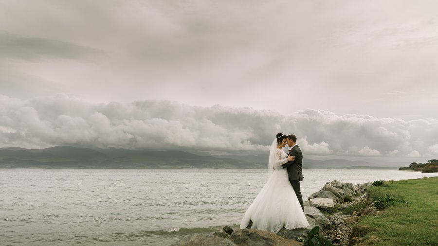 bride and groom by Menai Straits. Get married in North Wales