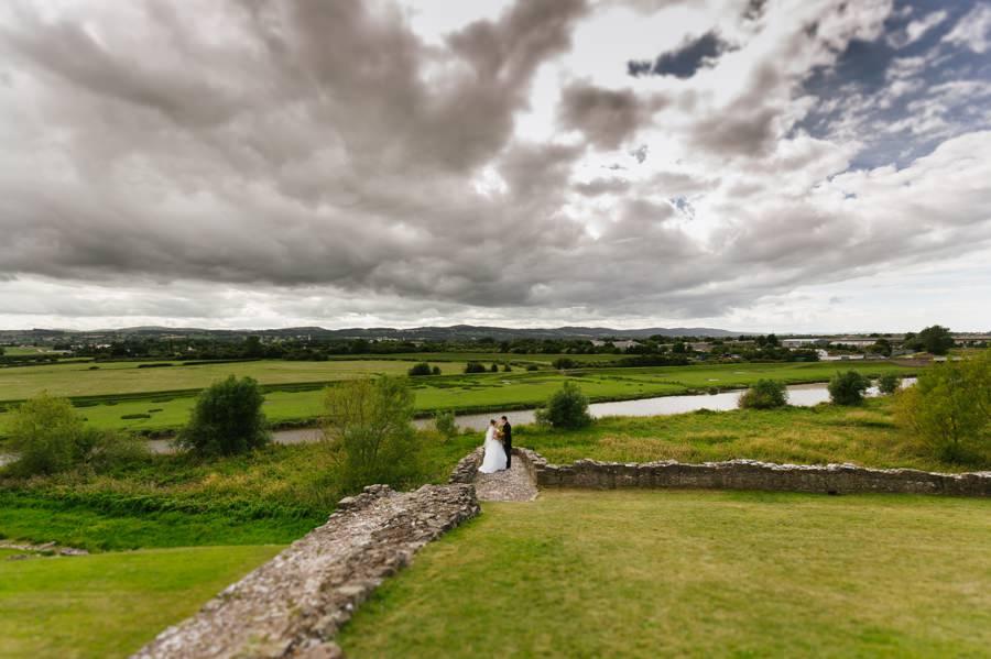 bride and groom in Rhuddlan castle. Get married in North Wales