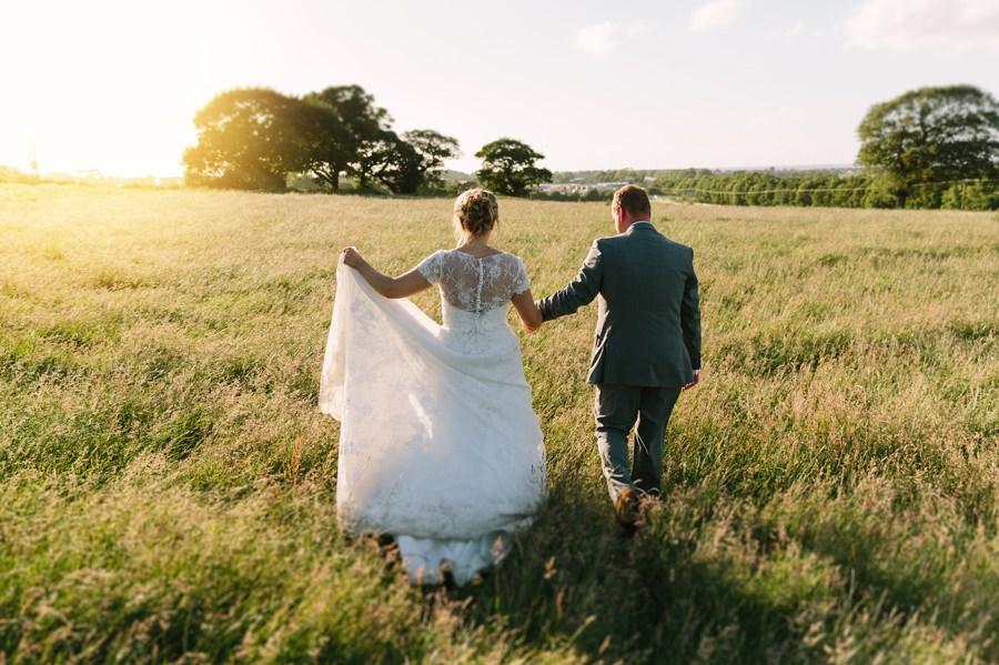 bride and groom in field near Kinmel hotel. Get married in North Wales