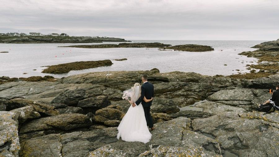 bride and groom overlooking Treaddur Bay. Get married in North Wales