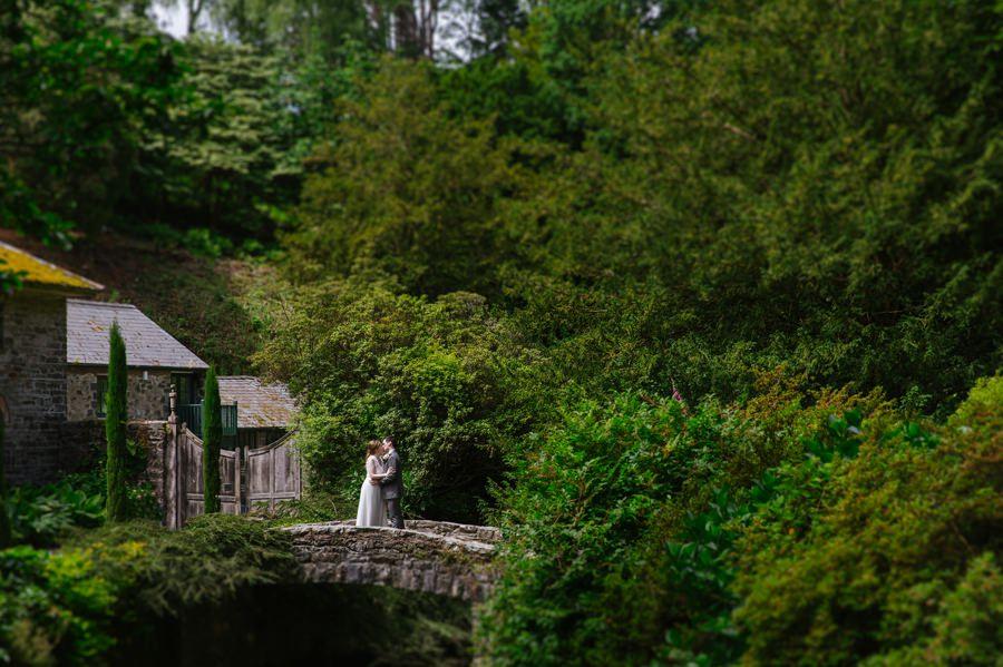bride and groom in Bodnant Garden