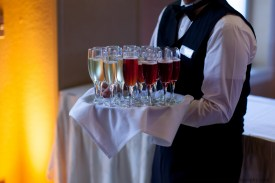 Server holding a tray of champagne at Chaminade