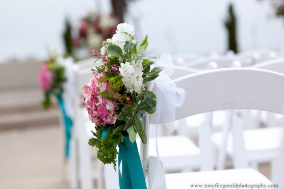 Flower decorations on chairs at wedding at Chaminade