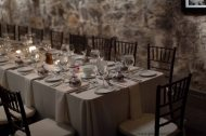 Testarossa winery cave with table setting for wedding rehearsal.