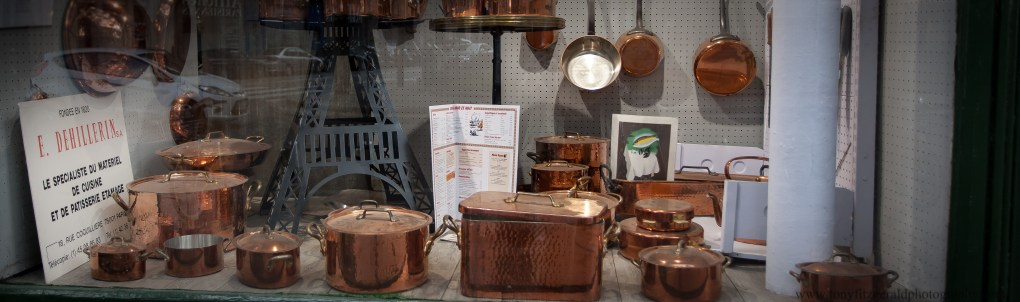 Copper pots in the window in Paris