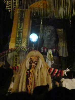 Rangda, the head witch and . Later in the show, a character tries to stab her, but fails.  The end of the ritual involved a dance of Rangda and a human body on the ground which might be dead or alive. It is paraded around a few blocks and then brought to the cemetery, where he revives.
