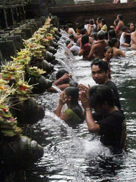 The first sequence of purification. Offerings are placed at the spout as a sign of good faith and pure intention in entering into the purification ritual.