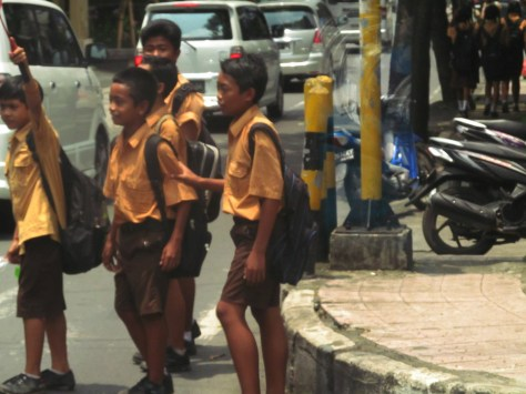School children in their uniforms are frequently seen on motorbikes or waiting for the bemo. Very sharp looking crowd.