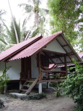 Gill's Bungalow was almost identical to mine, just a bit closer to the beach and with rustic wooden steps up to her balcony. She loved the place.