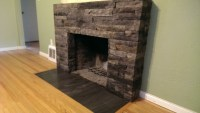 Fireplace with Stone veneer facing and ceramic tile hearth ...