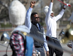 Anthony White, director of the L.A.U.S.D. Beyond the Bell All City Honor Band held practice for the Rose Parade in the parking lot around the Los Angeles Sports Arena. Los Angeles, CA. 12/31/2015 (photo by John McCoy/Los Angeles News Group)