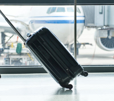 luggage-with-plane-behind