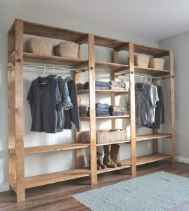 Industrial Style Wood Slat Closet System with Galvanized Pipes by Ana White
