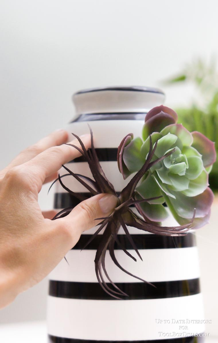 fuax succulent glued to striped vase