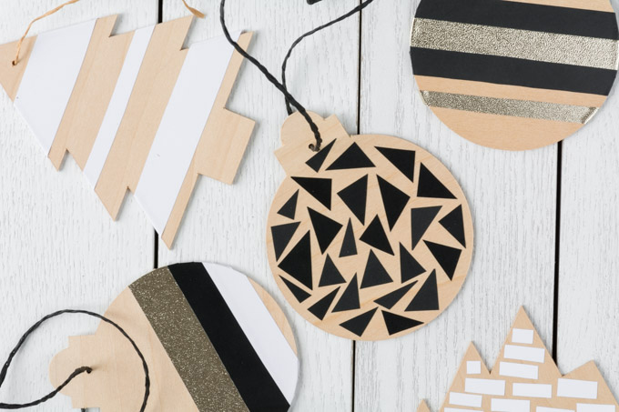 Wooden Basswood Christmas tree ornaments with vinyl details made with a Cricut machine.