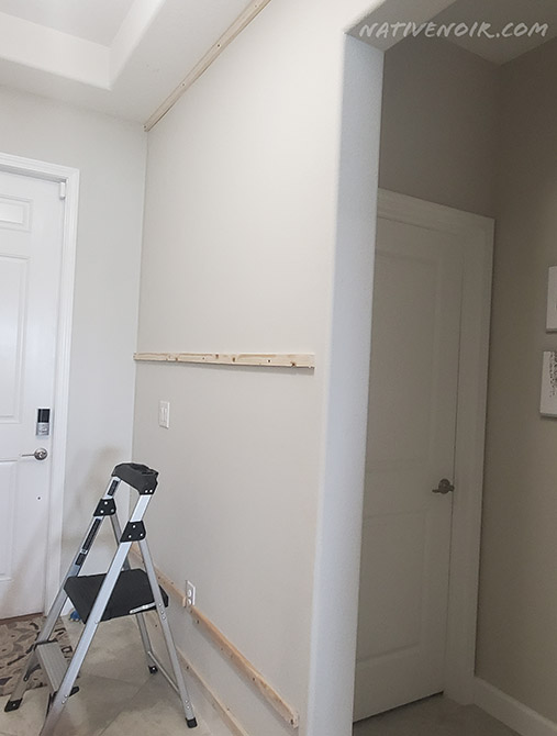 1x2s placed on the wall horizontally.