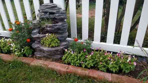 water fountain upcycled into a container garden