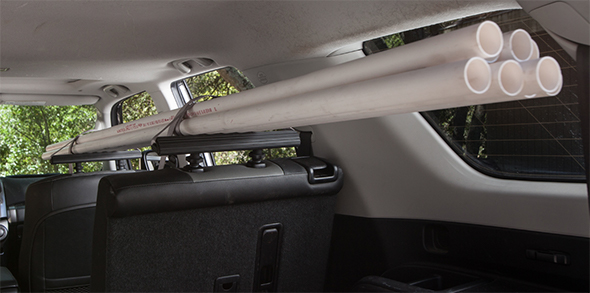 SeatRack Holding PVC Pipes Inside Car