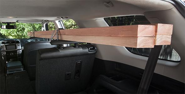 SeatRack Holding Wood Boards Inside Car