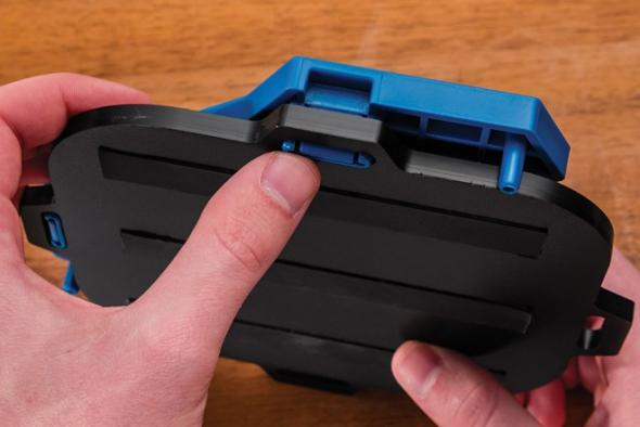 Closeup of the snaps that hold the Rockler routing templates in the handle