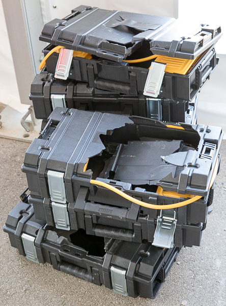 Pile of Smashed Dewalt ToughSystem Tool Boxes at Milwauke NPS17 Packout Demo