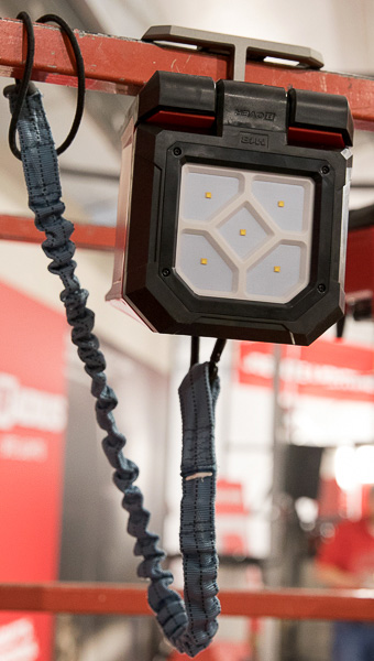 Milwaukee M18 Rover LED Light Clamped to Bar and with Tool Tether Attached