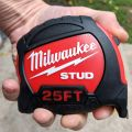 Milwaukee Stud 25ft Tape Measure in a medium sized hand