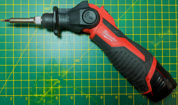 Milwaukee M12 Soldering Iron on the side with a 4Ah battery