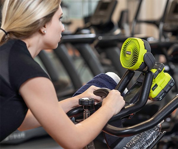 Ryobi Cordless Clamp-on Fan PCF02 Clamped to Exercise Bike