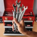 Craftsman Wrenches in Hand with Tool Box in Background