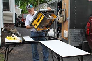 carrying dewalt saw