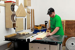 working on a cabinet table saw