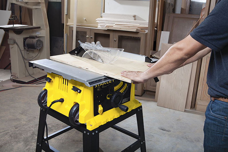 image of a man using a table saw