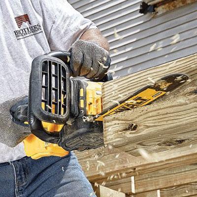 DEWALT DCCS620P1 cutting timber at home