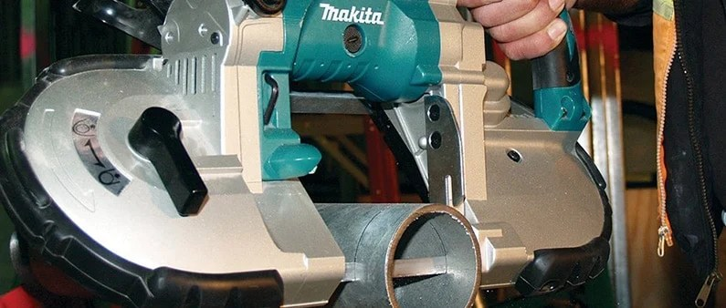 A Man Cutting Metal Pipe With Makita XBP02Z