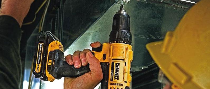 Man Using DeWalt to Drill Metal